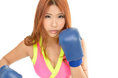 Beautiful Asian woman in pink with blue boxing gloves royalty free stock image