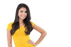 Beautiful Asian woman in plain yellow t-shirt posing with arm ak Stock Images