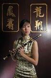Beautiful Asian Woman Playing Flute Royalty Free Stock Photos