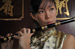 Beautiful Asian Woman Playing Flute Royalty Free Stock Photos