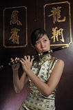 Beautiful Asian Woman Playing Flute Stock Image