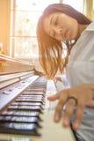 Beautiful asian woman playing piano Royalty Free Stock Image
