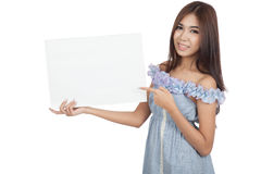 Beautiful Asian woman point to blank sign Royalty Free Stock Images