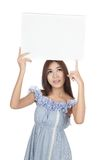 Beautiful Asian woman point to blank sign  over head Stock Photos