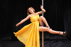 Beautiful Asian woman pole dance Stock Photography