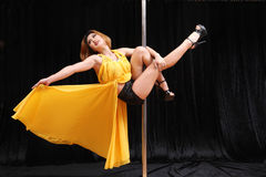 Beautiful Asian woman pole dance Royalty Free Stock Photo