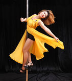 Beautiful Asian woman pole dance Stock Image