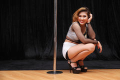 Beautiful Asian woman pole dance Royalty Free Stock Photography