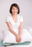 Beautiful asian woman. Portrait of Asian female sitting on bed at home Royalty Free Stock Photography