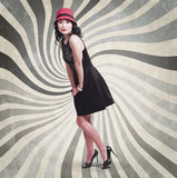 Beautiful asian woman posing. Vintage style. Glamour full length portrait of a young beautiful asian woman posing in red hat on vintage swirl background. Retro Stock Photography