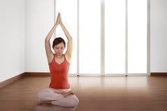 Beautiful asian woman practicing yoga Stock Images
