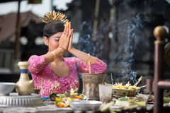 Beautiful Asian woman prays in the temple Stock Image