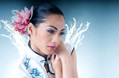 Beautiful Asian woman in Qipao Royalty Free Stock Photo