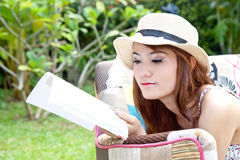 Beautiful asian woman reading her book Stock Photos