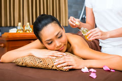 Beautiful Asian woman receiving massage Royalty Free Stock Photo