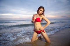 Beautiful asian woman in red bikini posing Royalty Free Stock Photos