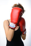 Beautiful asian woman with the red boxing gloves guard her face Stock Image