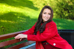 Beautiful asian woman in red coat Stock Photo