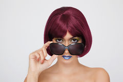 Beautiful asian woman with red hair. On grey background Royalty Free Stock Photography