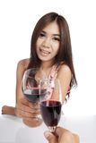 Beautiful Asian woman with  red wine cheers to another guy Royalty Free Stock Photo