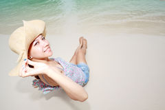 Beautiful asian woman relaxing on the beach Stock Images