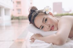 Beautiful Asian woman relaxing with hand massage treatment at be stock photo