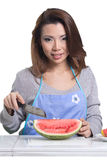 Beautiful asian woman. Relaxing in kitchen on white background with paths Stock Photography
