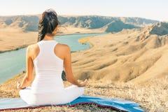 Beautiful asian woman relaxing and meditating outdoor at mountai Stock Photos