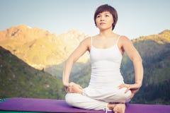 Beautiful asian woman relaxing and meditating outdoor at mountain Royalty Free Stock Photos