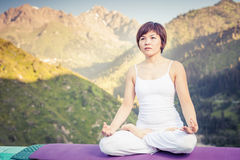 Beautiful asian woman relaxing and meditating outdoor at mountain Royalty Free Stock Photography