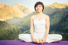 Beautiful asian woman relaxing and meditating outdoor at mountain Royalty Free Stock Photo