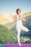 Beautiful asian woman relaxing and meditating outdoor at mountain Stock Photo
