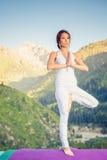 Beautiful asian woman relaxing and meditating outdoor at mountain Stock Photo
