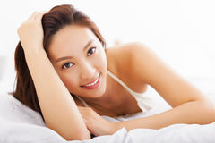 Free Beautiful Asian Woman Relaxing On The Bed Stock Image - 47259151