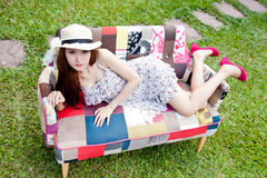 Beautiful asian woman relaxing on vintage sofa Stock Photography