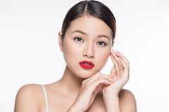 Beautiful asian woman with retro makeup with red lips isolated o Stock Photography