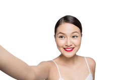 Beautiful asian woman with retro makeup with red lips taking sel. Fie photo isolated on white background Stock Photo