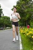 Beautiful Asian woman running. Stock Images
