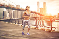Beautiful asian woman running in New york at sunset time. Stock Photo