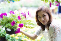 Asian woman select and buy flower. Beautiful Asian woman selecting flower in floral shop, lifestyle of modern housewife royalty free stock photo