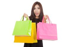Beautiful Asian woman shocked with  shopping bags in both hands Stock Photos