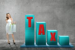 Beautiful asian woman with shopping bags and taxes text royalty free stock photos