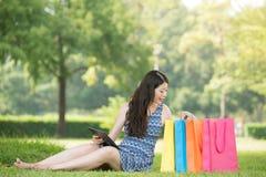 Beautiful asian woman shopping online choose gift Stock Photos