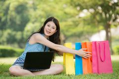 Beautiful asian woman shopping online holding gift Royalty Free Stock Photo