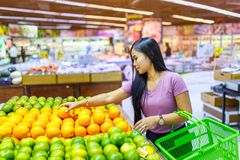 Beautiful asian women shopping vegetables and fruits in supermarket. Beautiful asian woman shopping vegetables and ts in supermarket, Bangkok stock photography