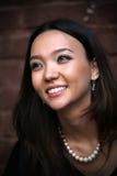 Beautiful asian woman. A shot of a beautiful asian woman outdoor Stock Photos