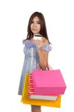 Beautiful Asian woman  show a credit card with shopping bags Stock Photography