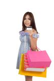 Beautiful Asian woman  show a credit card with shopping bags Royalty Free Stock Image