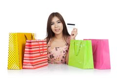Beautiful Asian woman show a credit card with  shopping bags on Royalty Free Stock Photography