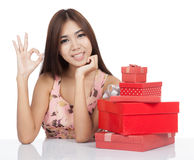 Beautiful Asian woman show OK with red gift boxs Stock Image